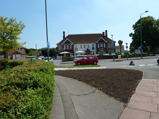 Bare flower bed opposite the Harvester