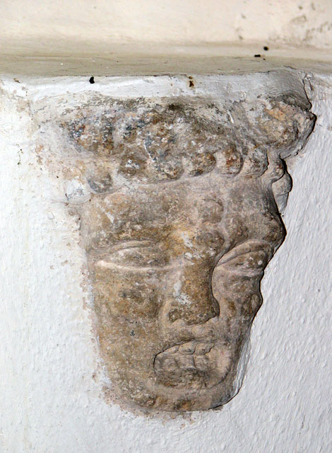 St Andrew's church in Holme Hale - stone head