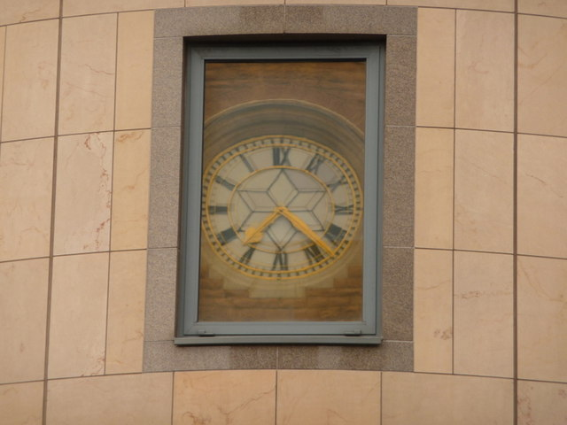 Hammersmith: St. Paul's clock reflected