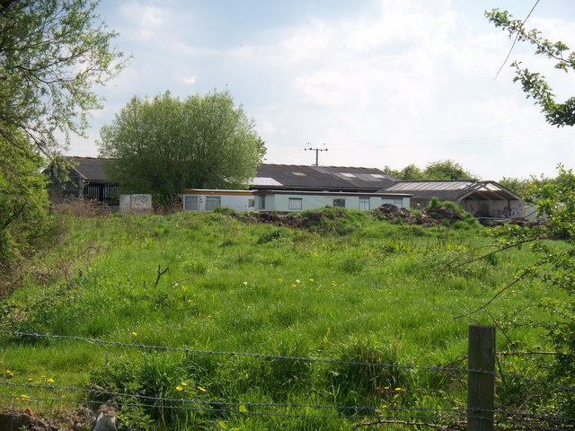 Farm buildings by the brook