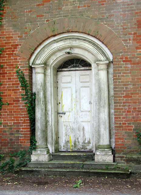 Door into a disused building in High Street, Northwold