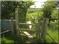 TQ9529 : Stile and footbridge on Saxon Shore Way near Mill Mound by David Anstiss