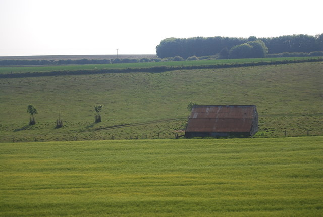 Derelict barn surrounded by pasture