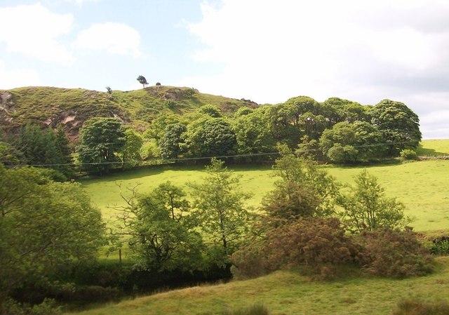 View across Afon Dwyfor to the hill fort above Tyddyn Mawr