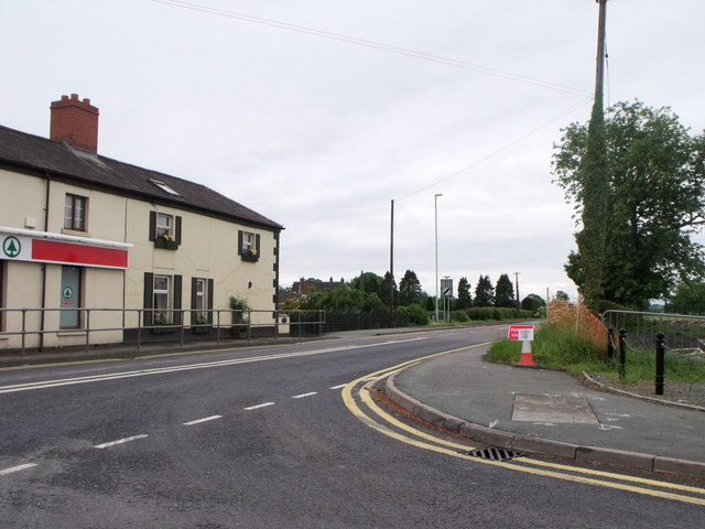 Junction of A483 and B4393 at Four Crosses, Shropshire