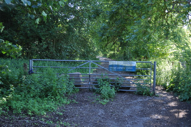 Gate across disused section of A48 leading to Sewage works