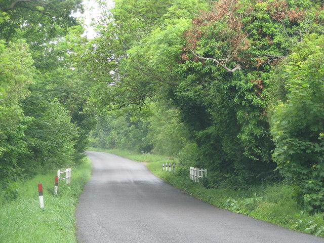 Minor road crosses small stream