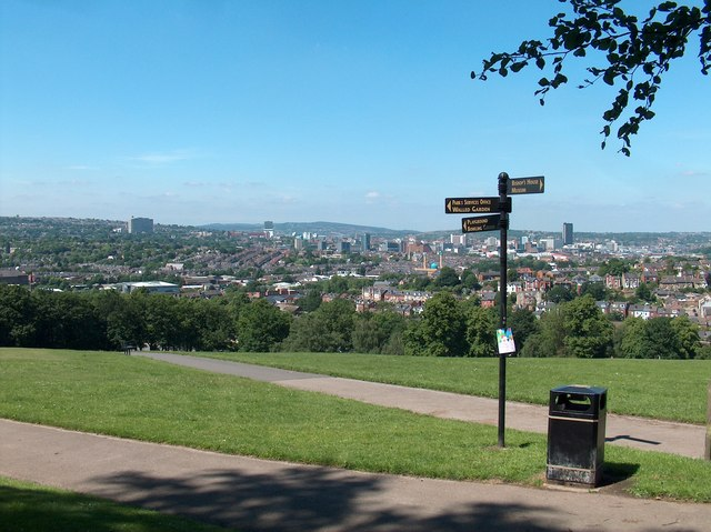 Signpost in Meersbrook Park with a panoramic view of Sheffield beyond