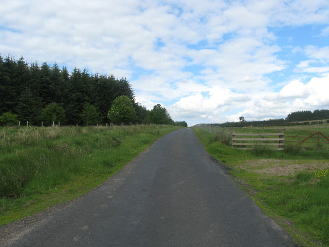 The road heads east in the shadow of the Cheviots