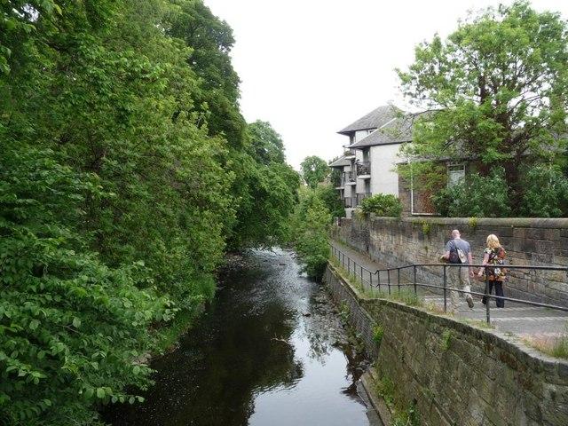 Upstream from the road bridge