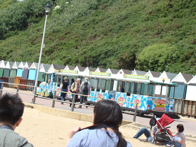 The land train passing the beach huts