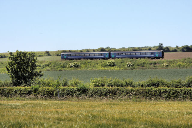 Train on the embankment, south of Newmarket
