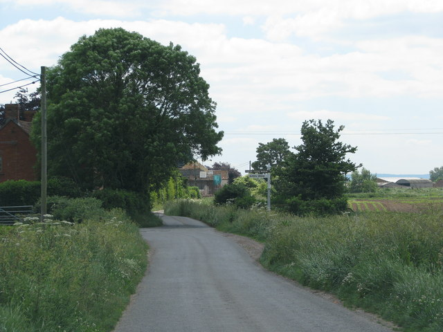 Road approaches the turning at Corner's Cottage