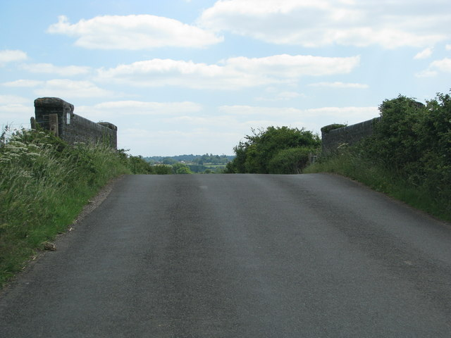 Minor road rises to cross the railway at West Lyng