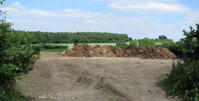 Manure heap in field