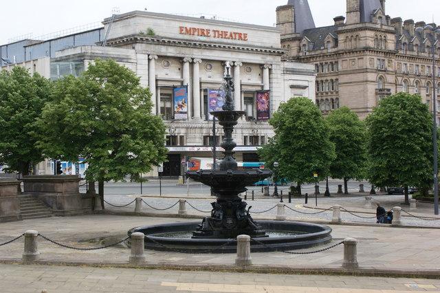 A fountain and The Empire Theatre