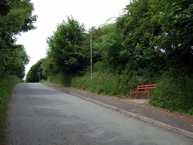 Red bench by the road