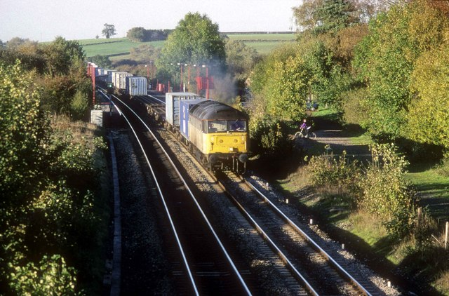 Container train passes Kings Sutton Station