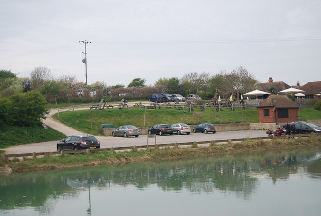 Cars parked by the River Cuckmere