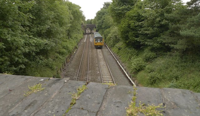 Rail line at Ashley Heath with oncoming Chester train