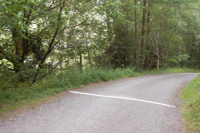 Lane to B4405 at level crossing