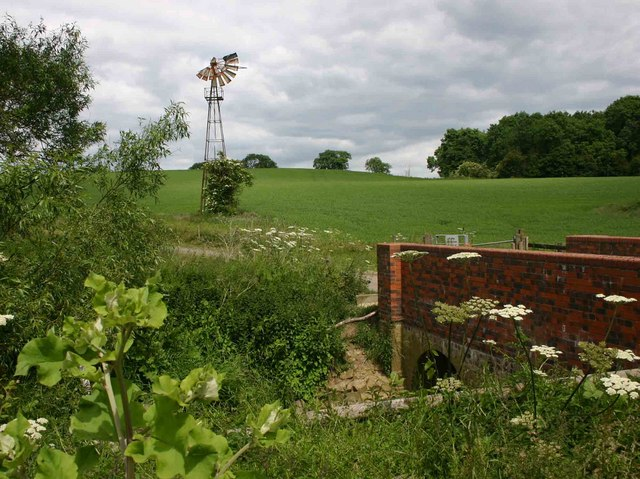Derelict windmill and bridge over Wagtail Brook