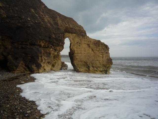 Sea washing through a sea arch