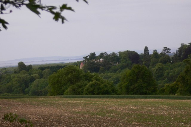 View of Idsworth House across field and woodland