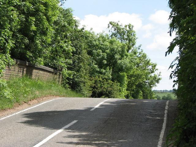 Humpbacked railway bridge at White Lodge