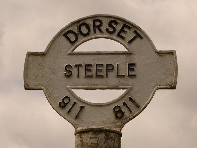 Steeple: detail of finger-post at village turn