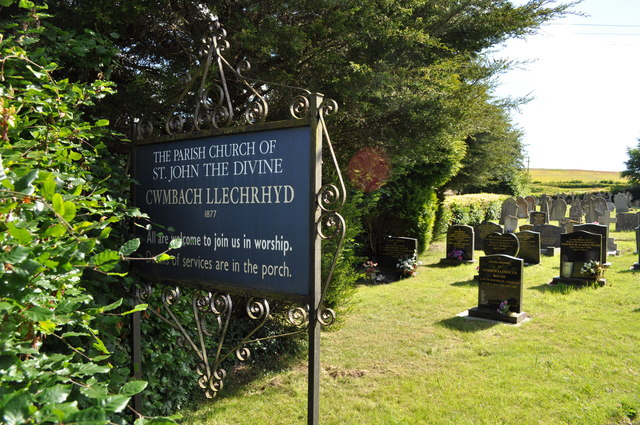 Church sign and graveyard