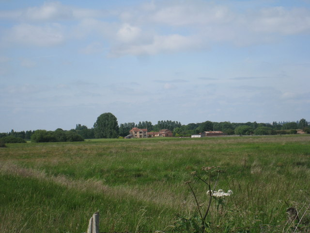 Looking across the meadows by the River Eau towards Newstead