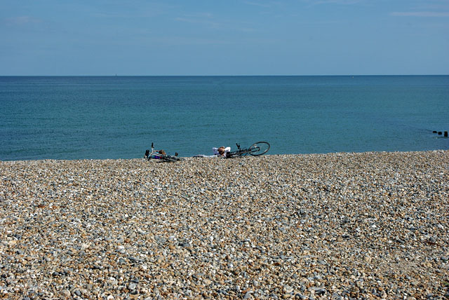 Cyclists relaxing on the beach, Atherington