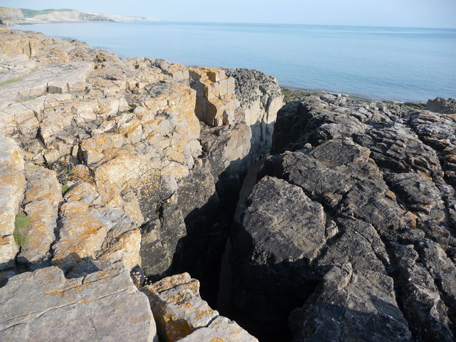 Chasm in coastal rock formations near Ogmore-by-Sea