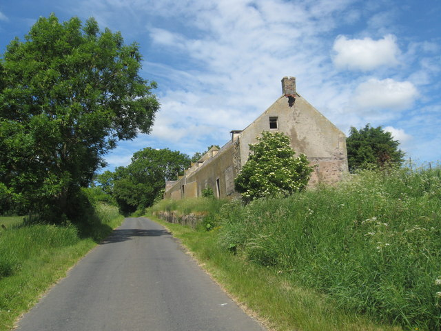 A row of old farm buildings