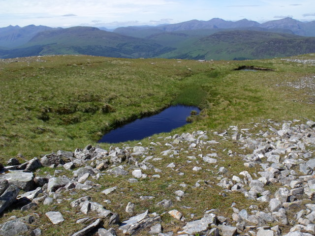 Two of a string of tiny hill lochans on the summit ridge of Beinn Bhreac-liath near Tyndrum