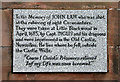 This stone for John Law is set into the north wall of the church.