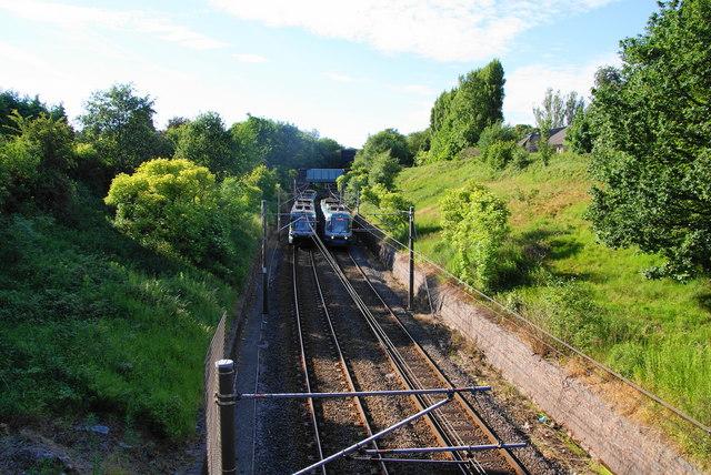 Metrolink trams passing between Woodlands Road and Crumpsall