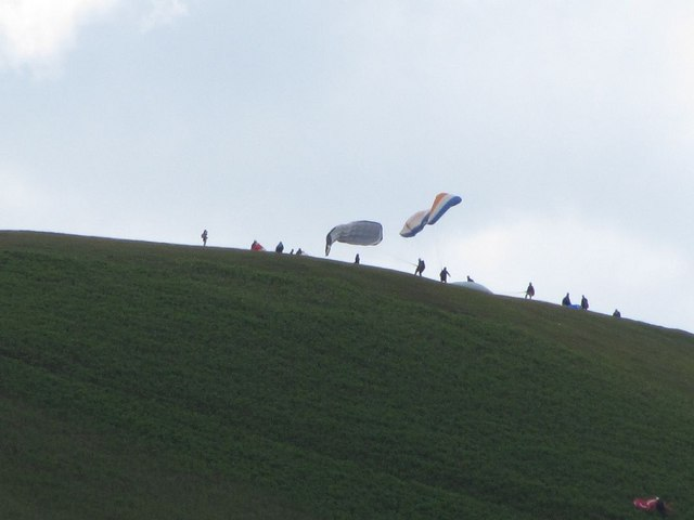 Paragliders on the hillside