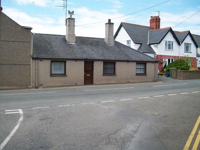 Cottage with tall chimneys at Efailnewydd