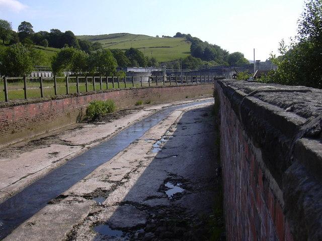 "River Calder behind ""Murt's Motor Centre"" Sandbed, Hebden Bridge, Calderdale, West Yorkshire"