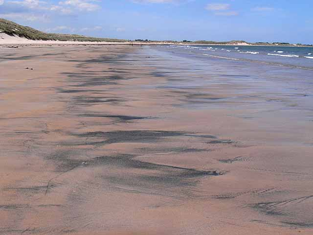 Coal dust in the sand, Beadnell Bay