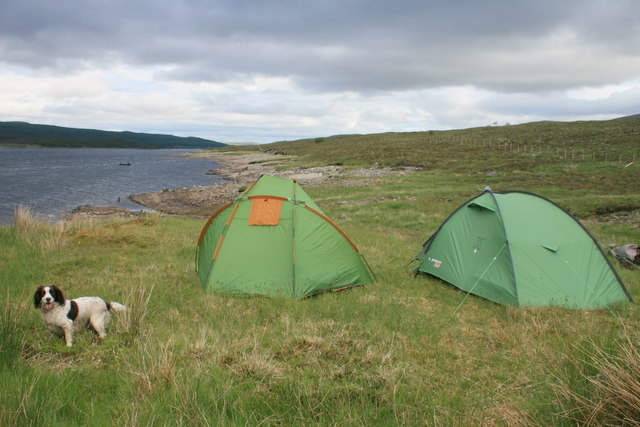 A tent and doghouse overlook Loch Shin