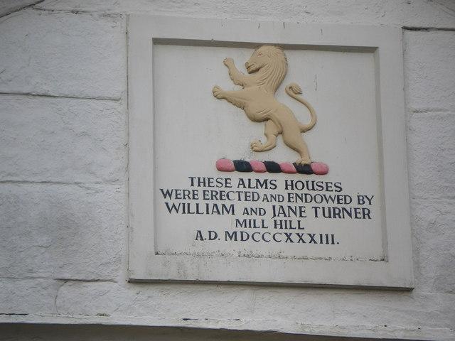 Description on plaque above Almshouses