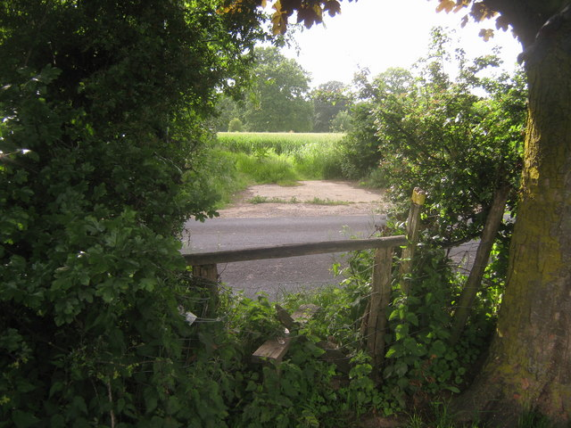 Footpath crosses Stone Street near Oast House Farm