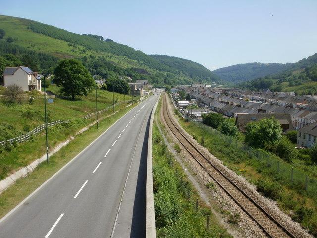 Road and rail viewed from Cwm footbridge