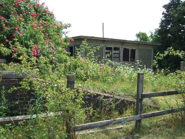 Platform edge and derelict railway hut