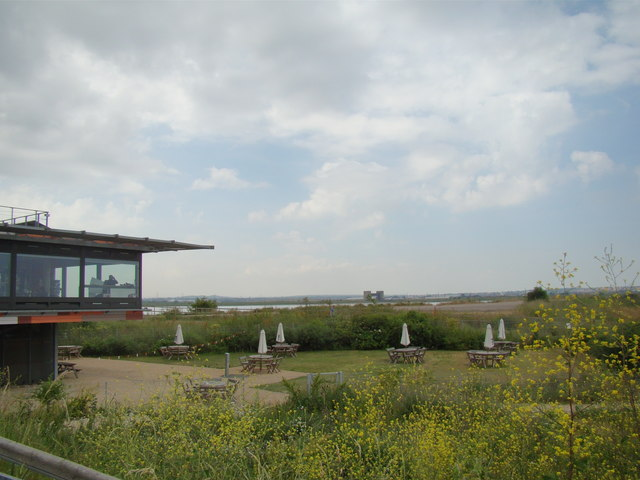 Dartford Flood Barrier against the foreground of the Rainham Marshes Information Centre