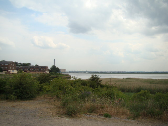 View of Littlebrook Power Station and houses on River Court from Rainham Marshes Nature Reserve