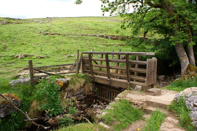 A gated footbridge at Crook Gill